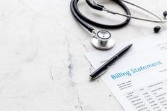 Medical treatment bill and phonendoscope on white background. Medical treatment bill and phonendoscope on white desk background stock image