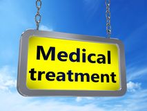 Medical treatment on billboard. Medical treatment on yellow light box billboard on blue sky background Stock Images