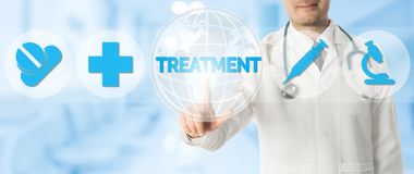 Doctor Points at TREATMENT with Medical Icons stock photography
