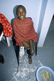 Medical treatment of legs of Maasai boy Royalty Free Stock Image