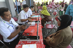 Medical treatment. Old women were getting medical treatment at a village in Sukoharjo, Central Java, Indonesia royalty free stock photography