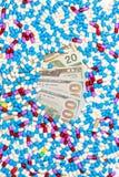 Medical treatment and US dollar banknotes. Medical drug treatment and US dollar banknotes stock image