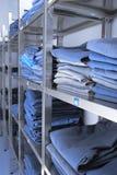 Medical unform folded in stacks for the storing.  Stock Images