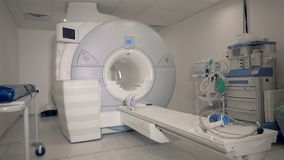 Medical unit with a modern MRI scanning machine in it. 4K stock video footage