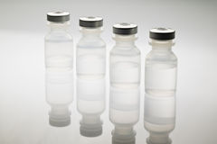 Medical vials containing saline solution Stock Photography