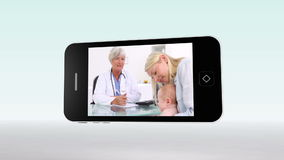Medical videos on a smartphone Royalty Free Stock Photos
