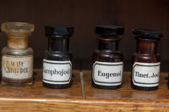 Medical vintage bottles of ancient pharmacy. Old  medical vintage bottles in stomatology ambulance Stock Photos