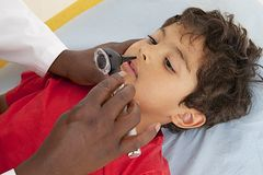 Medical visit - young boy- examination of the nose Stock Photo