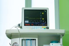 Medical vital signs monitor instrument in a hospital. This health care device displays and monitors heart rate and. Oxygen levels in hospital patients royalty free stock photos