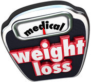 Medical Weight Loss Scale Words Help Assistance Supervised Diet. Medical Weight Loss words on a scale to illustrate losing weight on a diet with the help of Royalty Free Stock Image