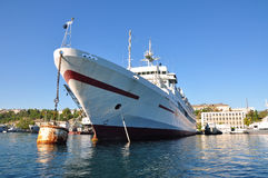 Medical white ship  with a red cross in port Stock Photo