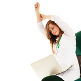Medical. Woman doctor working on computer laptop. Medicine. Tired overworked woman doctor in lab coat working on computer laptop stretching isolated on white Royalty Free Stock Photo