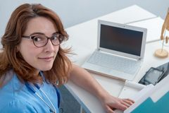 Medical woman doctor working with laptop Stock Images