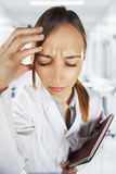 Medical woman with headache at hospital Stock Photo