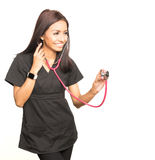 Medical woman wearing scrubs with stethoscope Stock Photo