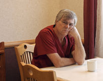 Medical worker. Medical intern contemplating the day ahead with a cup of coffee stock photography