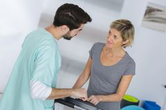 Medical worker communicating with middle aged woman. Medical worker communicating with middle aged women medical Royalty Free Stock Image