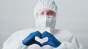 Medical worker nurse googles face mask heart sign