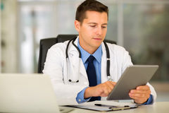 Medical worker office. Successful medical worker using tablet pc in modern office royalty free stock photos