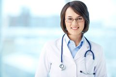 Medical worker. Portrait of a young medical worker with positive attitude stock images
