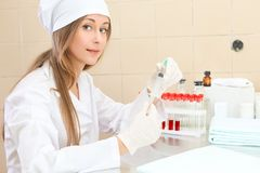 Medical worker with tubes blood tests Royalty Free Stock Image