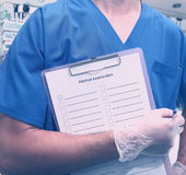 Medical worker whith clipboard in hospital Royalty Free Stock Photography