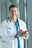 Medical worker writing. On clipboard in hospital royalty free stock photos