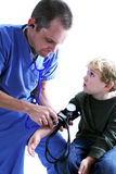 A medical worker and a young b. A medical worker taking a young boy's blood pressure Stock Image