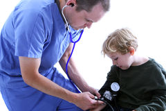 Medical worker and young boy. A medical worker taking a young boy's blood pressure Stock Images