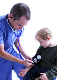 Medical worker and young boy. A medical worker taking a young boy's blood pressure Royalty Free Stock Photos