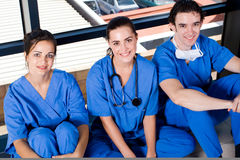 Medical workers. Group of young medical workers relaxin in hospital hallway during break royalty free stock image