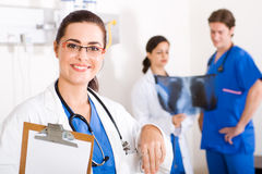 Medical workers. 3 medical workers in hospital ward royalty free stock images