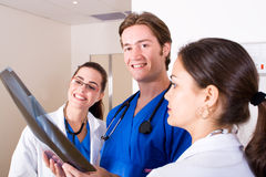 Medical workers. Young medical workers in hospital ward royalty free stock photography