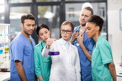 Medical workers analyzing test tube in laboratory stock photo
