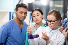 Medical workers analyzing test tube in laboratory Royalty Free Stock Image