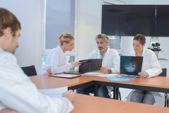 Medical workers sharing notes and scans stock photography