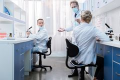 Medical workers talking in laboratory stock photography