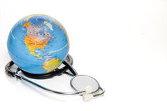 Medical World. A globe of the Earth and a medical stethoscope stock photography