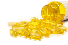 Medical yellow pills isolated Stock Images