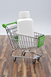 Medicament. Shopping cart with a box of medicines Stock Photography