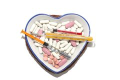 Medicaments in a porcelain dish in the shape of a heart Stock Images