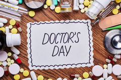 Medicaments, tools and greeting card. Creative surprise for a doctor Royalty Free Stock Photos
