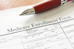 Medicare. Closeup of Medicare enrollment form and pen Stock Photos
