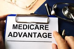 Medicare advantage in a clipboard. Royalty Free Stock Images