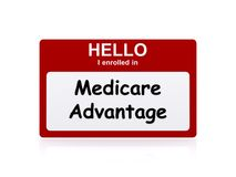 Medicare advantage. Red name badge with white text Hello, I enrolled in and black text Medicare Advantage on white royalty free illustration