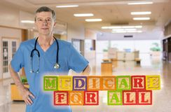 Medicare for All message built from wooden blocks. Medicare for All political policy for health insurance in wooden blocks against doctor background stock image