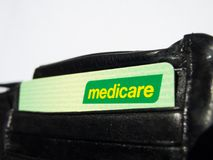 Medicare card is a publicly funded universal health care system in Australia, the image shows the card in a black wallet. SYDNEY, AUSTRALIA – On February stock photo
