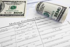 Medicare enroll. Ment form and cash Stock Image