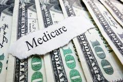 Medicare money. Medicare newspaper headline on assorted money Stock Images