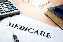 Medicare policy. Medicare policy on a desk Royalty Free Stock Image